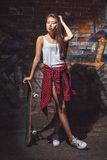 Teen girl with skate board, urban lifestyle. Beautiful asian teen girl with skate board. Outdoors, urban lifestyle royalty free stock images