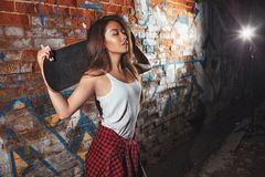 Teen girl with skate board, urban lifestyle. stock images