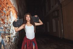 Teen girl with skate board, urban lifestyle. royalty free stock image