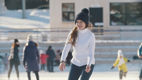 Teen girl skating on outdoor public ice rink. Youth pastime and rest stock footage