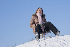 Teen girl sledding. From a hill Royalty Free Stock Images