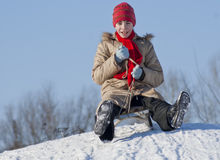 Teen girl sledding. From a hill Stock Photography