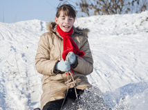 Teen girl sledding. From a hill Royalty Free Stock Photos