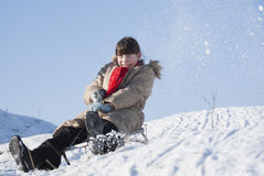 Teen girl sledding. From a hill Stock Photo