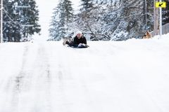 Teenage girl on a snow sled royalty free stock photo