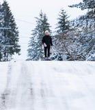 Teenage girl on a snow sled stock photo