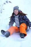 Teen girl sledding Stock Images