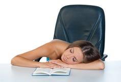 Teen girl sleeping with open book. Attractive teen sleeping at the table with open book Stock Photo