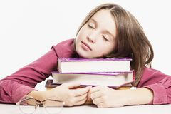 Teen girl sleeping on a stack of books, close-up royalty free stock images