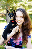 Teen girl with a small dog Stock Photography