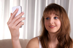 Teen girl and a smartphone. Royalty Free Stock Image