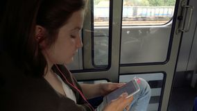Teen girl with the smartphone at  train. Teen girl with the smartphone at the train stock video