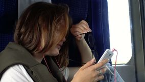 Teen girl with the smartphone at  train. Teen girl with the smartphone at the train stock footage