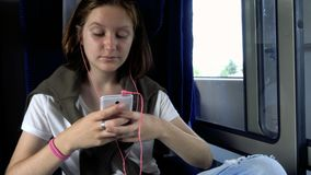 Teen girl with the smartphone at  train. Teen girl with the smartphone at the train stock video footage