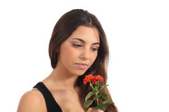 Teen girl smelling a flower. Thinking in a white background Stock Photography