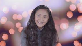 Teen girl smiles at the camera