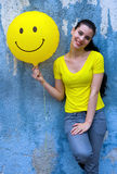 Teen girl with smiley balloon Royalty Free Stock Photo