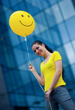 Teen girl with smiley balloon Stock Photo