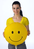 Teen girl with smiley balloon Royalty Free Stock Photos