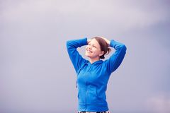 Teen girl smiling with raised arms Stock Photos