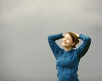 Teen girl smiling with raised arms Royalty Free Stock Photography