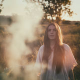 Teen girl with smoke bomb. During summertime Stock Photo