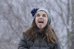 Teen girl in the snow stock photos