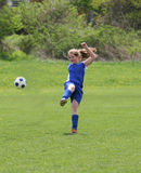 Teen Girl Soccer Player In Action 8. Teen Girl Soccer Player Kicking ball in the air Royalty Free Stock Image