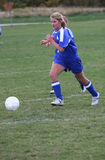 Teen Girl Soccer Player Chasing Ball Royalty Free Stock Photo