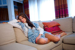 Teen girl on the sofa Stock Images