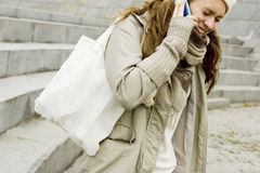 Teen girl speaking by phone Stock Photography