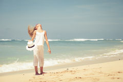 Teen girl  standing on the beach at blue sea shore in summer vac Stock Image