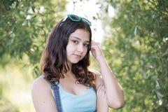 Teen girl standing near tree. A Teen girl standing near the tree Stock Photo
