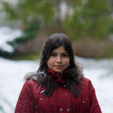 Teen girl standing in the snow Stock Photos