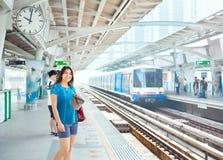 Teen girl standing on train platform station Stock Photography