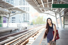 Teen girl standing on train platform station Stock Photography