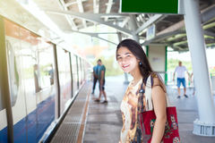 Teen girl standing on train platform station Stock Image