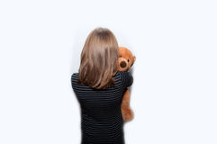 Teen girl stands with a bear Royalty Free Stock Photo