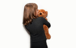 Teen girl stands with a bear Royalty Free Stock Photos