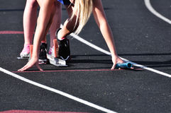Teen Girl in the Starting Blocks Stock Images