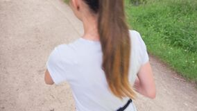 Girl runner with smart watch