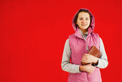 Teen girl staying with a book Royalty Free Stock Images