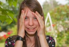 Teen girl staying outdoors Stock Image