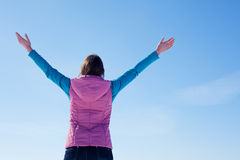 Teen girl staying with raised hands Royalty Free Stock Photos