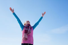 Teen girl staying with raised hands Stock Images