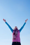 Teen girl staying with raised hands Royalty Free Stock Photo