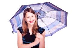 Teen girl staying under umbrella Royalty Free Stock Image