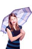 Teen girl staying under umbrella Royalty Free Stock Photos