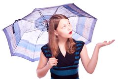 Teen girl staying under umbrella Stock Photo