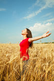 Teen girl staying at a wheat field Stock Image